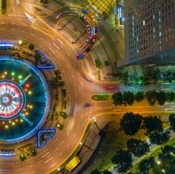 a city roundabout at night represents circular movement