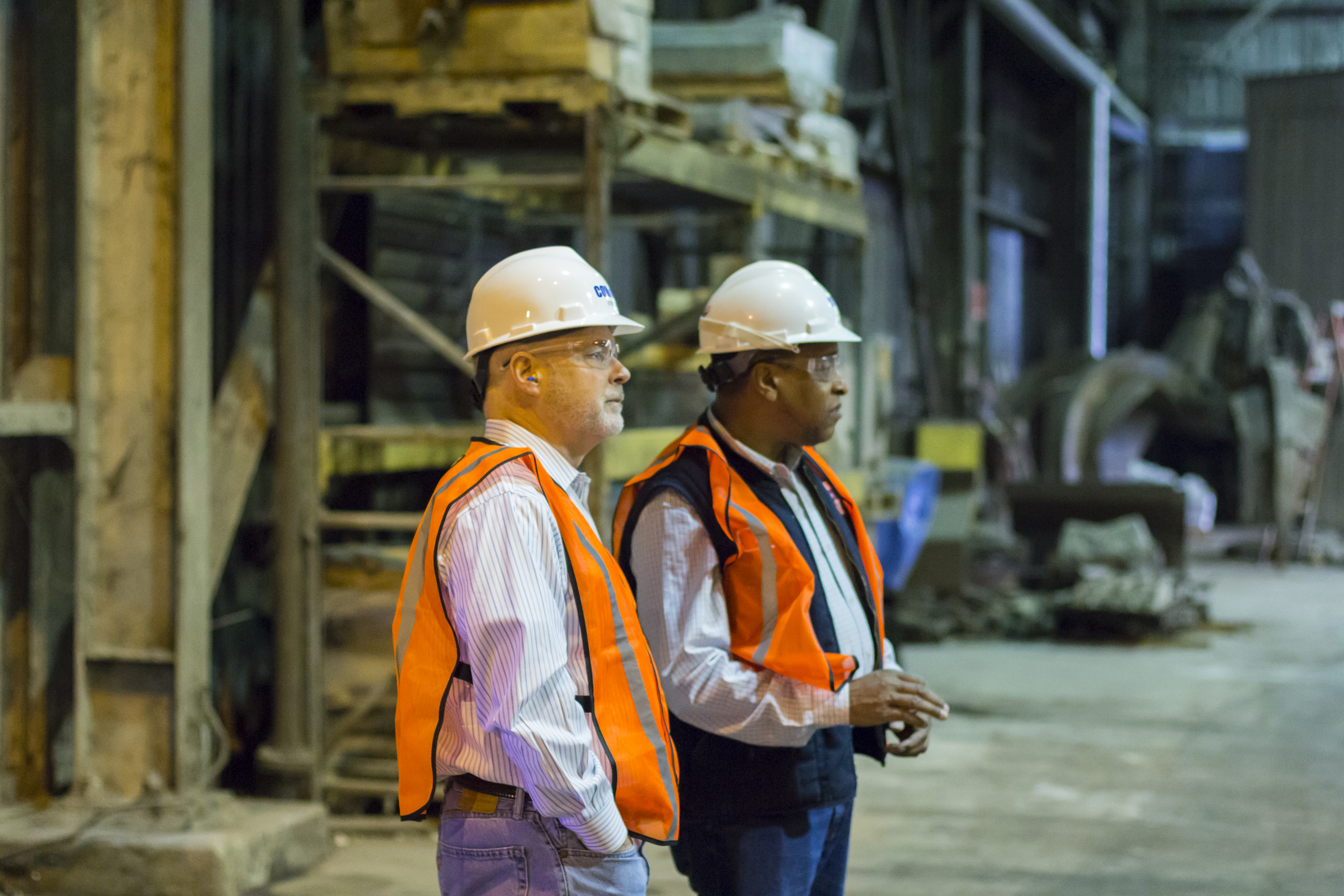 CEO, Steve Jones, stands in the Union, NJ WTE facility withe a fellow employee.