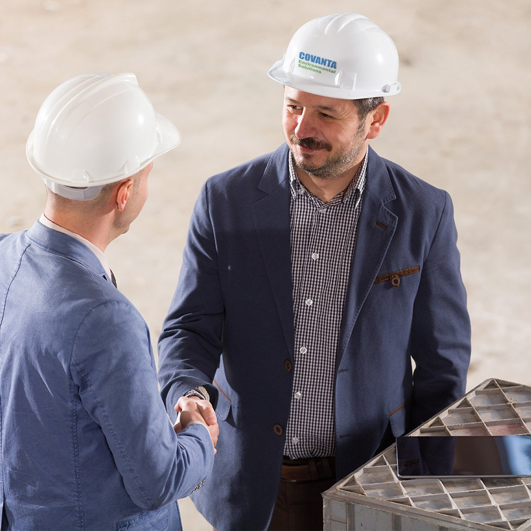 Covanta Environmental Solutions employee shaking hands with customer