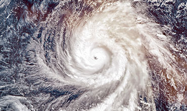 Aerial view of eye of a hurricane representing climate change