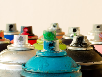 Aged aerosol cans of various colors