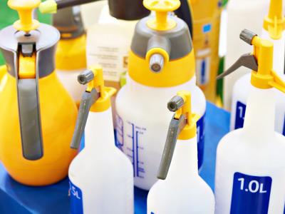 Pesticide bottles on a blue table