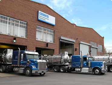 A fleet of Milwaukee trucks stand by, waiting to pick up waste from the next customer.