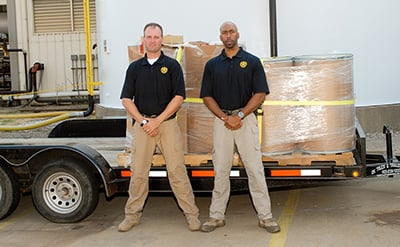 Two men of the Oklahoma Bureau of Narcotics posing with pharmaceutical waste