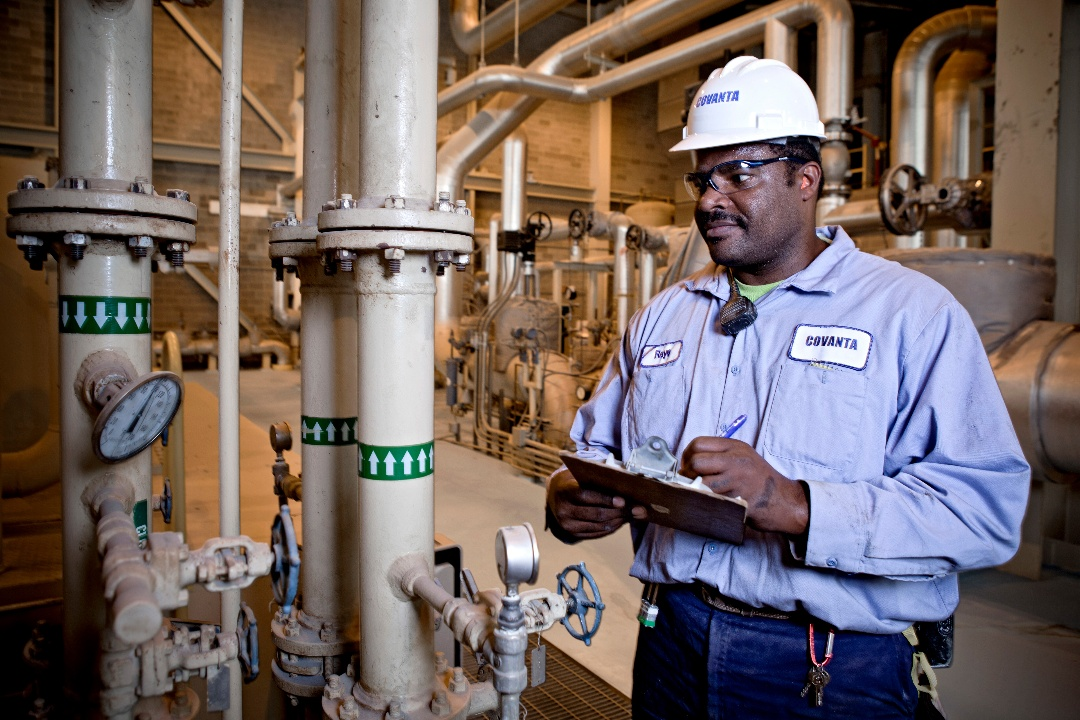 Covanta employee looking at pipes