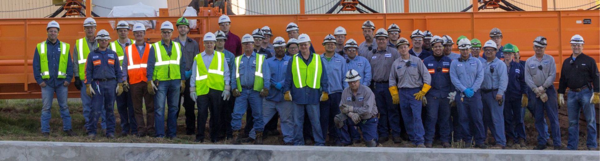 The Fairfax Covanta team lines up outside the facility