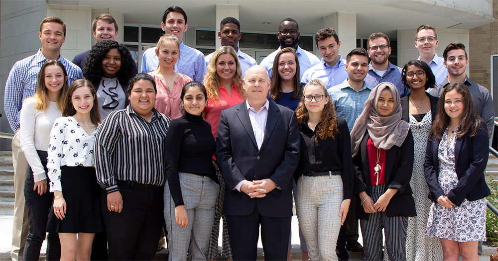 2019 class of interns pose in front of Morristown HQ with CEO, Steve Jones