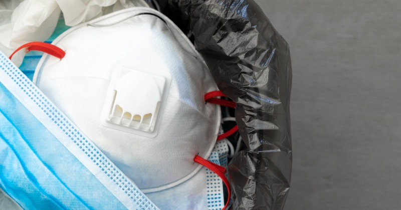personal protective equipment in the trash