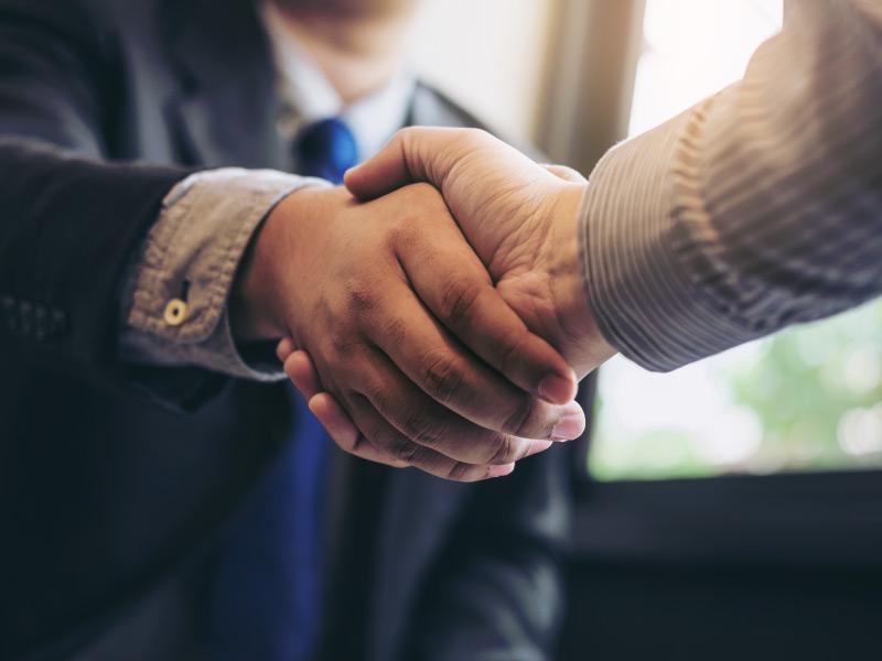 a handshake between businessmen